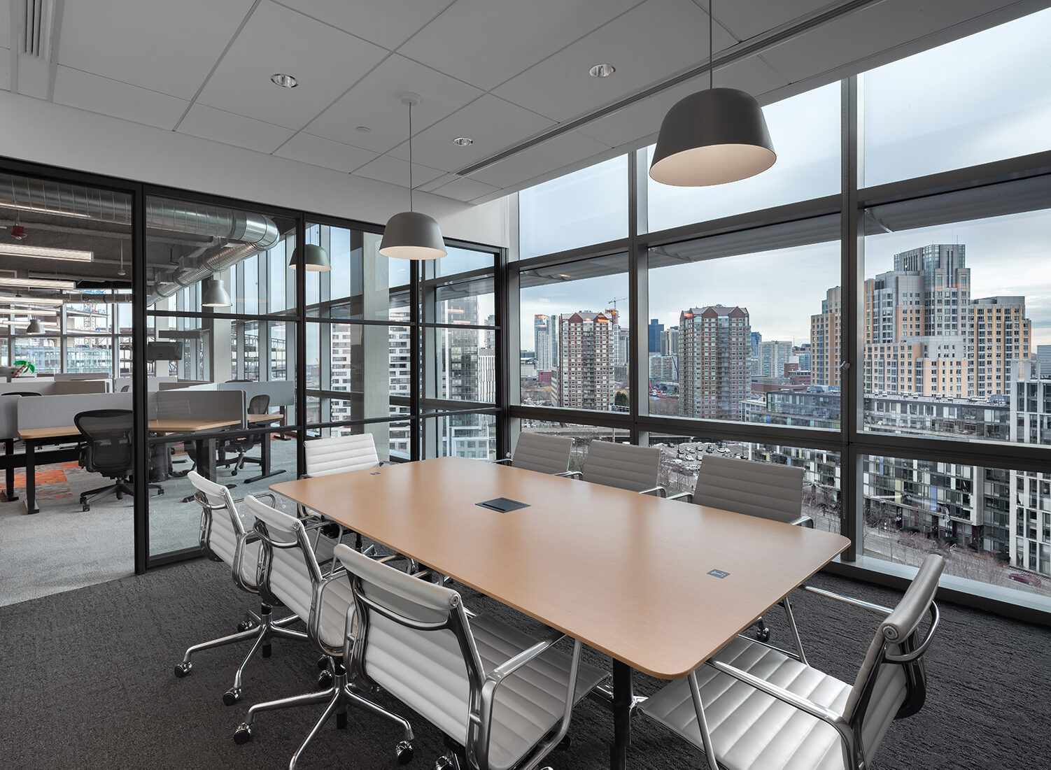 Herman Miller Eames Executive Chairs around conference table at Thrive Headquarters by Creative Office Pavilion