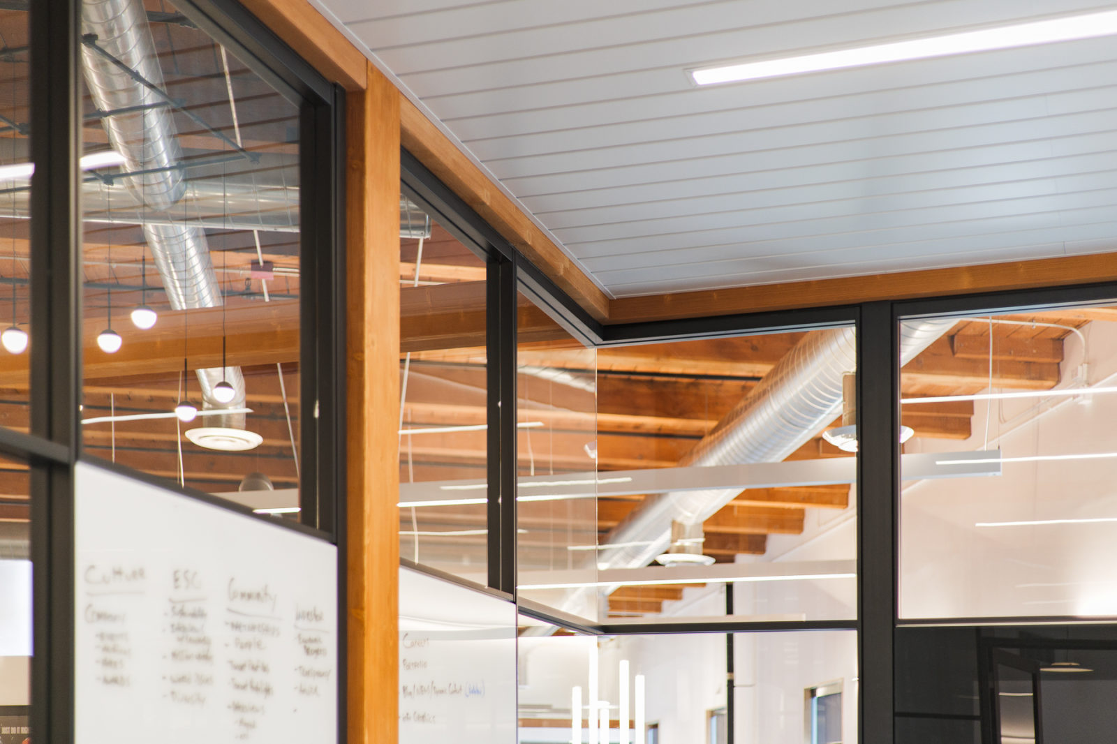 DIRTT glass walls with integrated markerboard in conference room